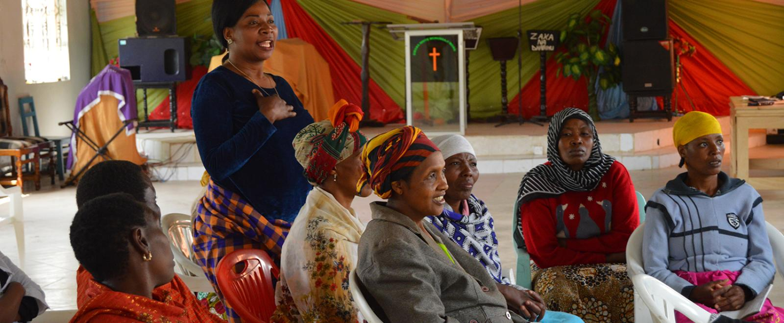 Local women attend a training session hosted by women's empowerment volunteers in Tanzania.